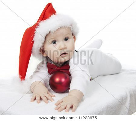 The Lovely Child In A Christmas Hat On A White Background