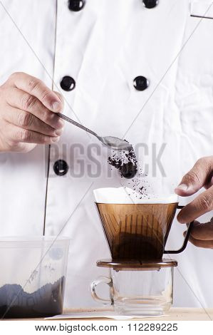 Chef Putting Grind Coffee