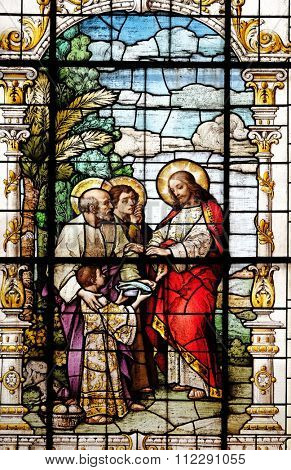 ZAGREB, CROATIA - MAY 28: The Multiplication of the Loaves and Fish, stained glass window in the Basilica of the Sacred Heart of Jesus in Zagreb, Croatia on May 28, 2015