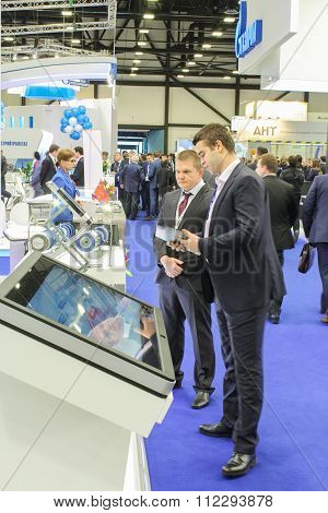 Two Business Man In Front Of A Large Monitor On The Forum.