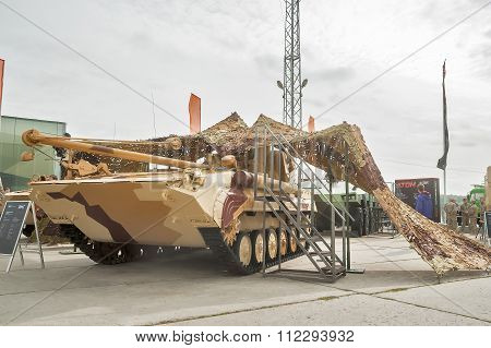 Tracked repair vehicle RMG under camouflage net