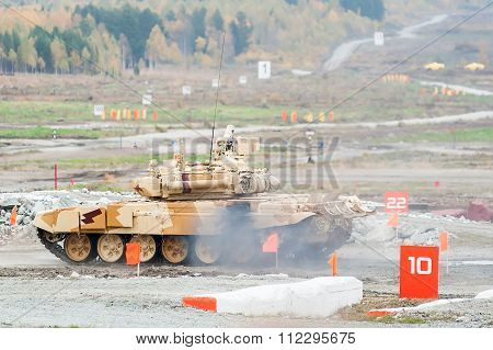 Tank T-90S moves with turret turned back