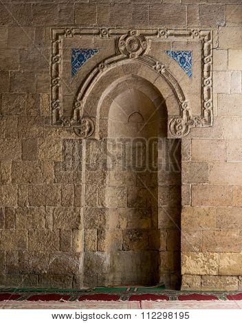 CAIRO, EGYPT - December 19 2015: A stone wall with a sculpted Mihrab, Old Cairo
