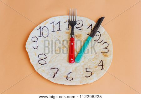 A Clock Made Of Piadina Marks Lunchtime