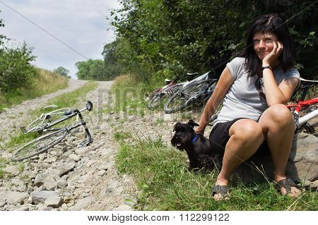 Woman With Her ??dog Resting