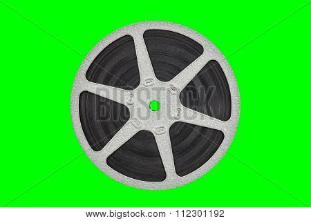 Old metal film reel isolated with chroma key green background.