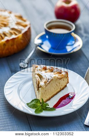 Apple pie with drop of jam on white plate