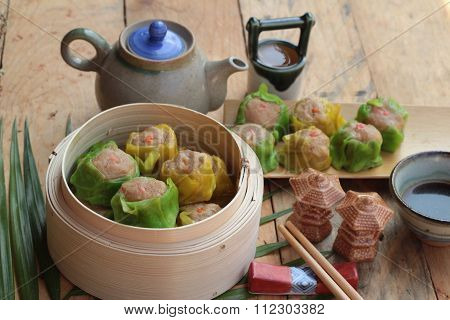 Chinese Steamed Dumpling And Hot Tea Delicious.