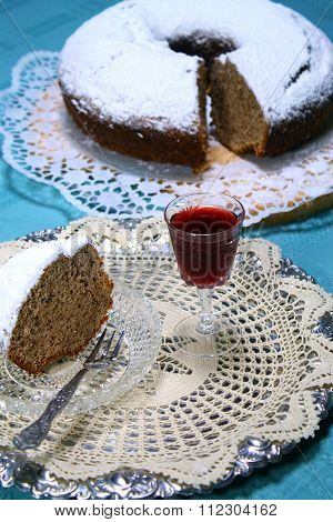 slice of and apple cake with homemade  liquor for a treat