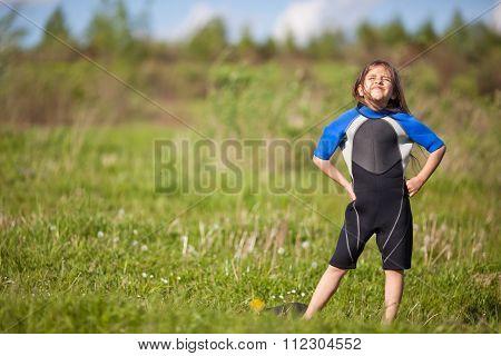Portrait Of Little Girl In Wetsuit