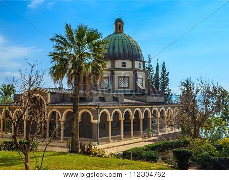 Catholic monastery and a small church Mount of Beatitudes. Beautiful park of cypress and palm trees. Israel, Sea of Galilee