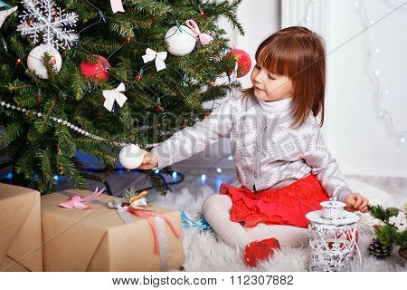 Little Girl In Beautiful Christmas Decorations.