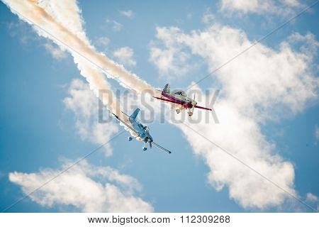 Two Stunt Planes Cross Paths