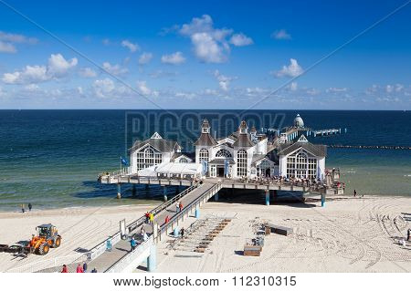 Famous Pier With Historical House In Sellin.