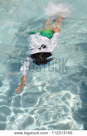 Japanese boy swimming in the pool (5 years old)