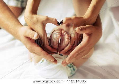 Family hands of his father, mother and scildren