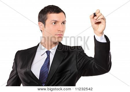 View Of A Young Businessman Holding A Pen