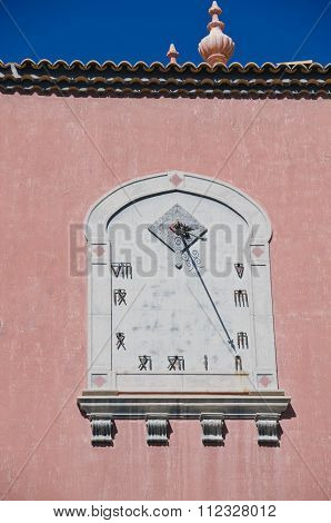 Antique Sundial On House Wall