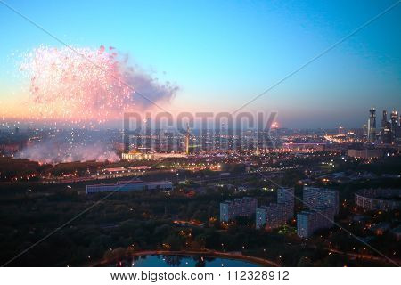 panoramic view of residential area of city with beautiful fireworks during celebration of May 9 Victory Day