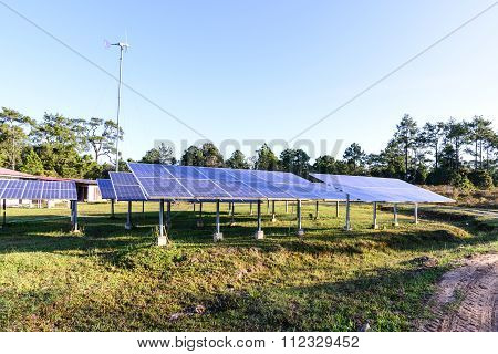 Solar Cells For Renewable Solar Energy With Sun And  Wind Turbine.