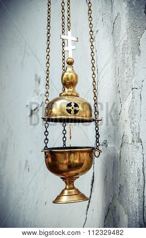 censer chain weighs nearly a white wall