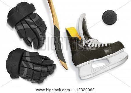 Hockey Skates, Stick, Gloves And Puck