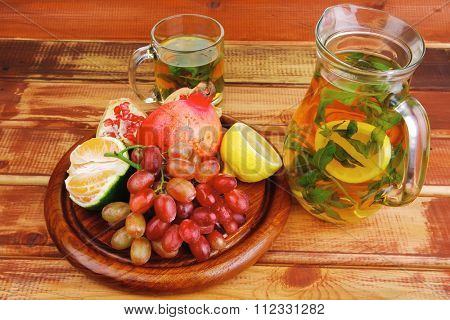tea pot and fruits on wooden table