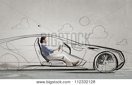 Young humorous woman driving drawn funny car