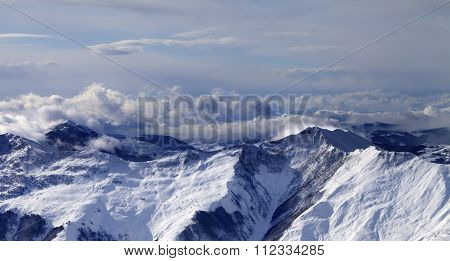 Panoramic View On Winter Mountains In Clouds