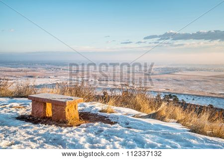 sandstone bench in Colorado foothills overlooking Fort Collins and prairie, winter scenery