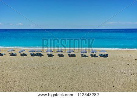 Umbrellas lined up on the Katisma Beach, Lefkada