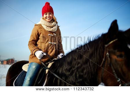 Beautiful girl riding horse on hippodrome