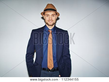 Handsome well-dressed man looking at camera