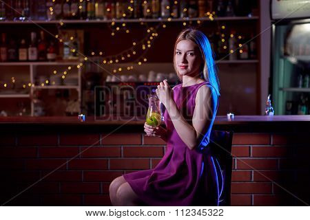 Woman Sitting At The Bar