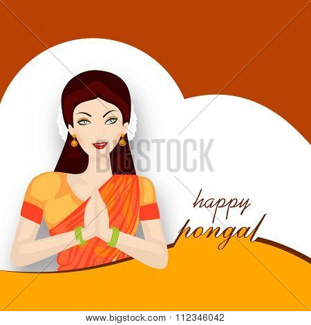 Beautiful young girl in Indian traditional greeting pose (Namaste) for South Indian harvesting festival, Happy Pongal celebration.