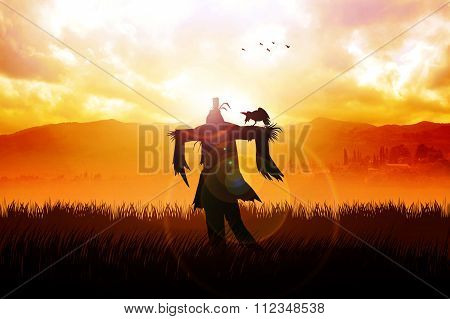 Silhouette of a scarecrow on a field