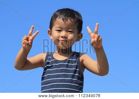 Japanese boy under the blue sky (3 years old)