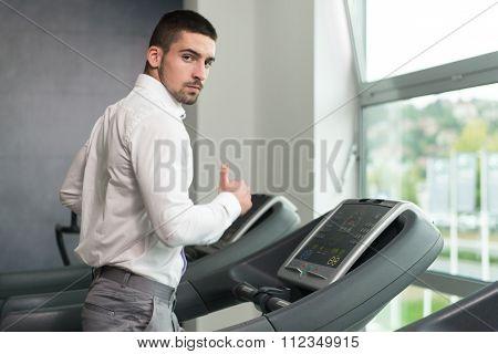 Businessman Exercising On A Treadmill