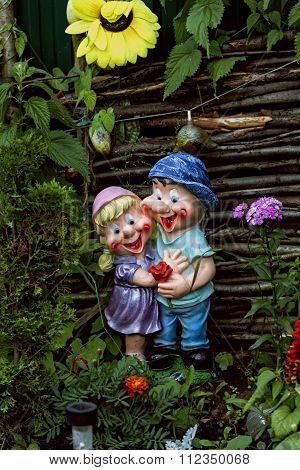 Decorative Figurines In Summer Garden