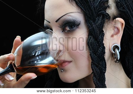 Young Stylish Woman With Dreadlocks Drinks Red Wine