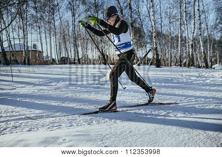 male skier middle-aged of classic style in winter woods on sports race