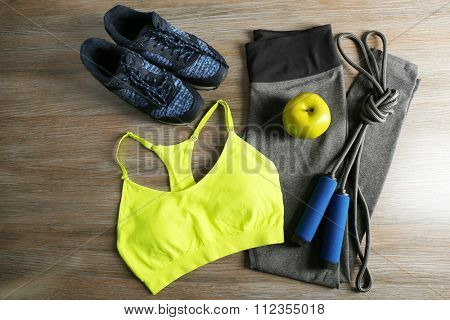Sport clothes, shoes on wooden background