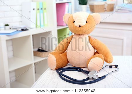Toy bear in a doctor's office