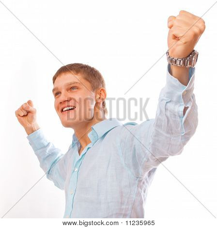 Portrait of young man celebrating success