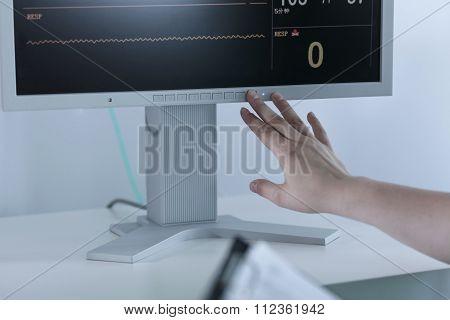 Nurse Turning Off Electrocardiogram
