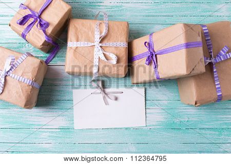 Wrapped Boxes With Presents  And Empty Tag