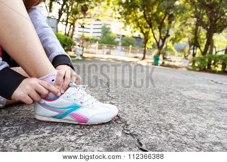 Concept of Sports injury. Woman pain in ankle while jogging.