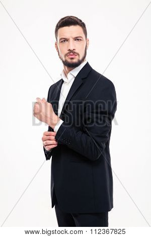 Portrait of a serious businessman standing isolated on a white background