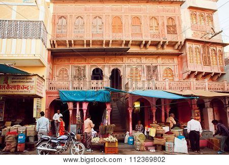 Many People Buying Food And Spices In Shops On Historical Street Of Indian City