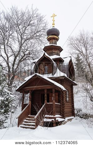 Small Wooden Chapel In Winter Time